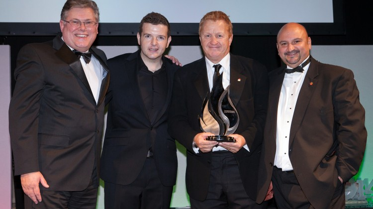 Gary Morton receives Award for Excellence in recognition of charity work